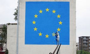 A Brexit-inspired mural by Banksy showing a metalworker chipping away at a star on the EU flag, 8 May 2017, Dover UK.