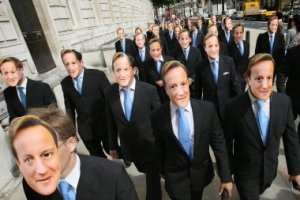 Cloning Protestors wear David Cameron Masks