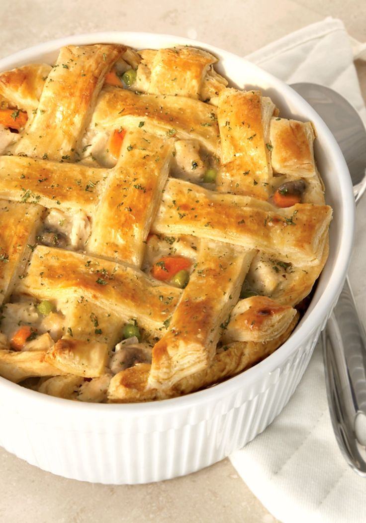 """The Ultimate Chicken Pot Pie –a light and flaky puff pastry crust is what makes this pot pie recipe """"The Ultimate"""".  It's a great way to turn leftover chicken and veggies into a whole new and delicious dinner dish."""