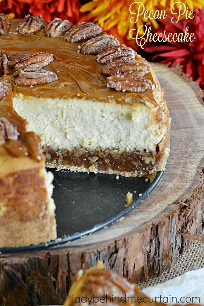 Pecan Pie Cheesecake | A layer of pecan pie filling with a creamy cheesecake center topped with caramel and sugared pecans.