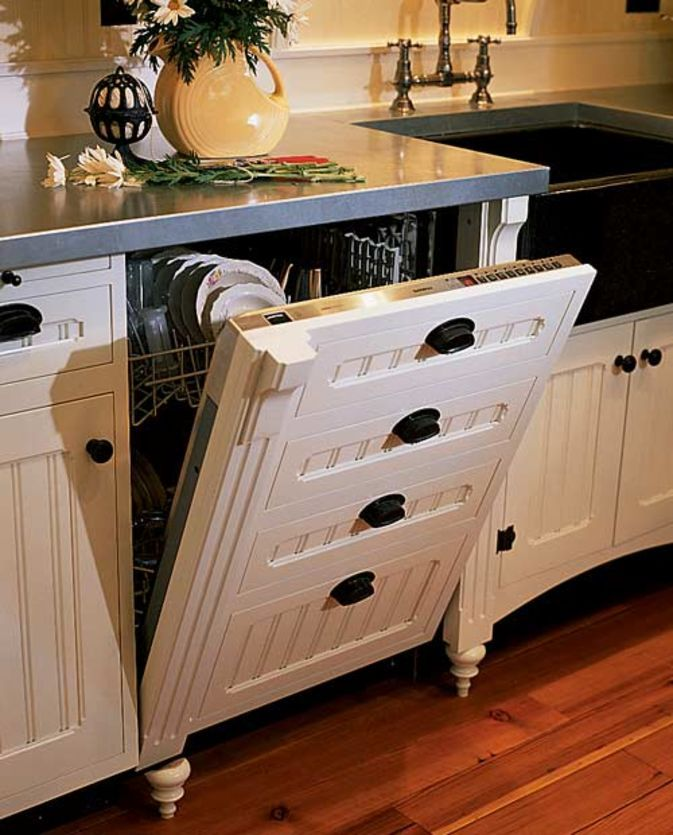 Hide your dishwasher with cabinets for a more rustic feel.