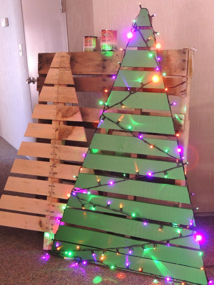 One pallet makes 2 Christmas Trees. Just cut pallet, reinforce any loose strips.  Add General Finishes Emerald Green Milk (http://bit.ly/1DtimMC) Paint, Brown Milk Paint (http://bit.ly/1nx6lBR) for the tree trunk post, and decorate with your fav lights, and you've got a homemade outdoor decoration.