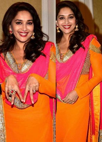 Madhuri Dixit looking fresh as ever in this vibrant pink and orange anarkali..