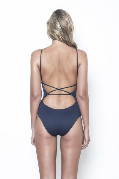 - Handmade in limited numbers using luxurious honeycomb textured Lycra- Features high neck keyhole front- Adjustable ties criss cross at back and thread thr...