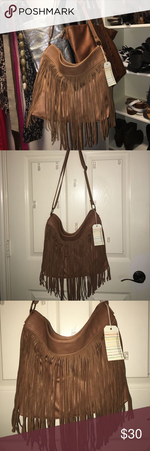 Gorgeous brown fringe bag. NWT I know, just bought it. It's beautiful. I just have too much stuff! Brown fringe bag. NWT Bags Shoulder Bags