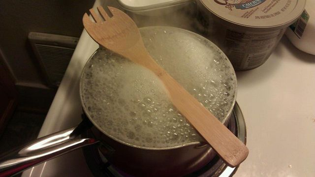 Use a wooden spoon to stop pots from boiling over - I hope this works!