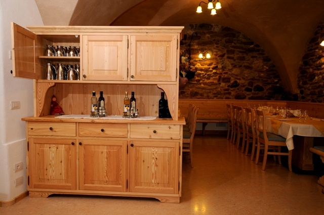 Rustic sideboard of brushed larch.