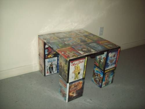 table made of DVD cases.  Would be an awesome gift for a movie buff!  Would need to be built on wood for stability, I think.  and stuff put into the cases on the top so they aren't hollow.