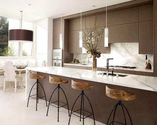 Love the stools. And the slab backsplash.