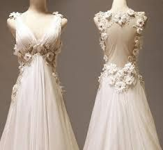 This is a kind of inspiration to what my wedding dress will look like. I love the flower touch.