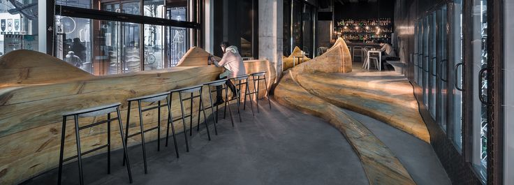 daipu architects fuses 'wood mountain' terrain with concrete for a pub in chongqing