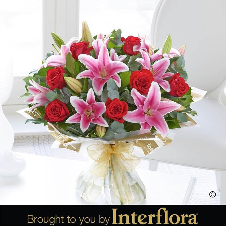 Valentines Rose and Lily Hand tied. #Roses and lilies are always a favourite combination, and there is no exception for #ValentinesDay. We've combined romantic red roses with pink lilies to create a beautiful gift for your special someone.