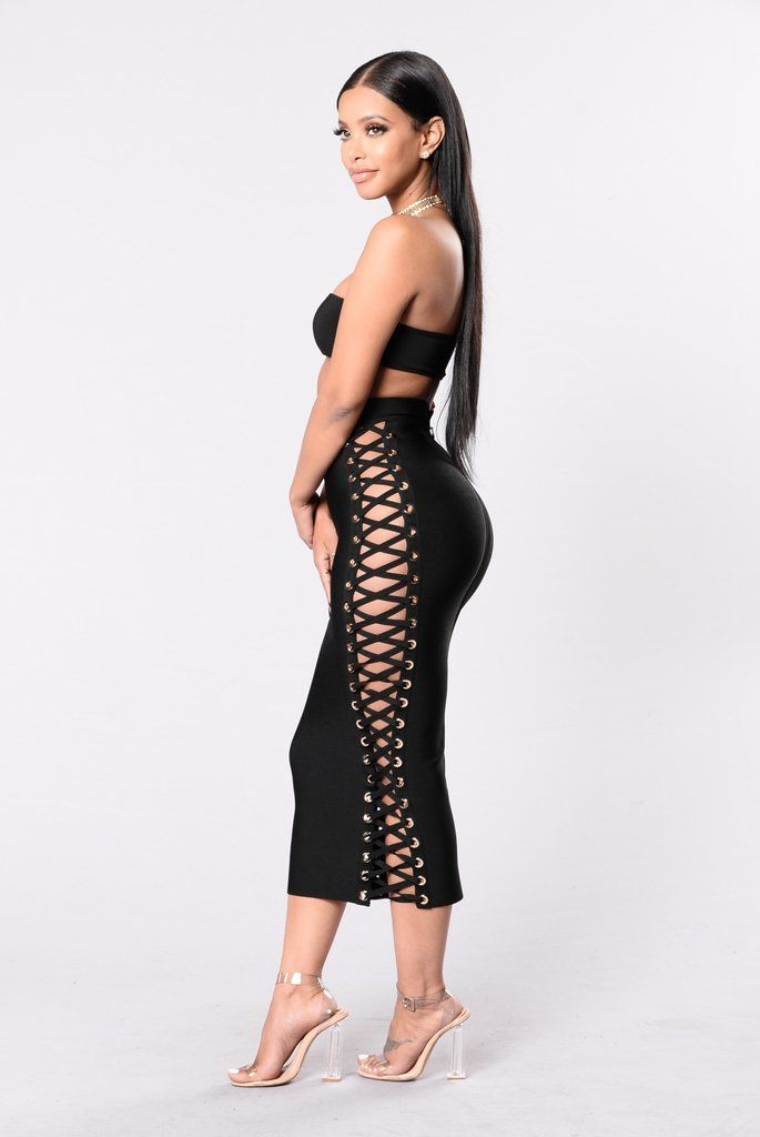 - Available in Black - Bandage Skirt - Lace Up Sides - Large Gold Eyelits - 90% Rayon 9% Nylon 1% Spandex