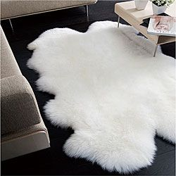 I already have an awesome rug, but I love the idea of layering something soft and cozy over it. $268: Sheepskin Rug, Natural White, Area Rugs, Living Room