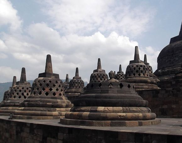 Borobudur, or Barabudur (Indonesian: Candi Borobudur) is a 9th-century Mahayana Buddhist temple in Magelang, Central Java, Indonesia, as well as the world's largest Buddhist temple,and also one of the greatest Buddhist monuments in the world. Yogyakarta Tour Package : http://nagantour.com/paket-wisata-jogja