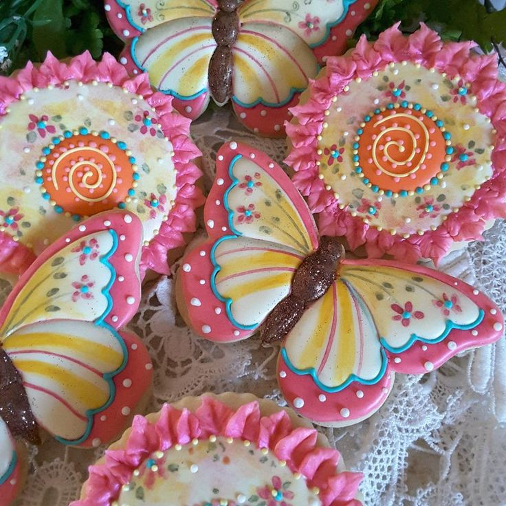 Happy! Butterfly and fantasy flower in cheerful hot pink, orange, and yellow; cookie artist, Teri Pringle Wood