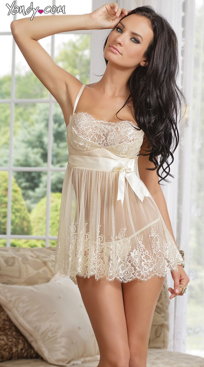 The Ivory Elegance babydoll set includes an ivory lace babydoll with satin underwire, padded demi cups, adjustable straps, satin ribbon sash with removable bow broach, hook and eye back with keyhole cut out and matching g-string panty.