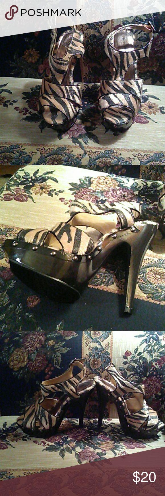 Pierre dumas size 7 animal print shoes platform. Worn once.  Platform sandals.  Closes at heel with buckle. Pierre Dumas Shoes Platforms