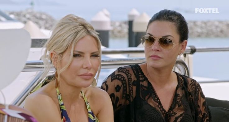 Nicole O'Neil wears Freya Swimsuit and Black Lace Kaftan with Rayban Aviators  Nicole and Melissa chat aboard the boat - The Real Housewives of Sydney Episode 5 Season 1 Recap S01E05