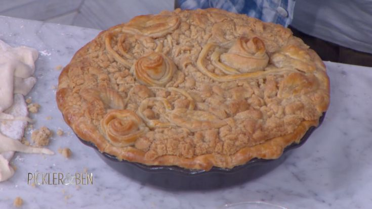 Ace of Cakes chef Duff Goldman shares his recipe for an Apple Streusel Pie, perfect to enjoy on Thanksgiving – or any day of the year! Adding decorative roses made from 3-inch dough circles is a beautiful way to decorate the pie. Need some pie decorating tips? Head here! Apple Streusel Pie Makes 1 (9-inch) pie Ingredients For the pie dough: Pinch kosher salt 1/8 teaspoon granulated sugar 2 1/4 cups all-purpose flour 3/4 cups (1 1/2 sticks) unsalted butter, cubed 1/2 c...