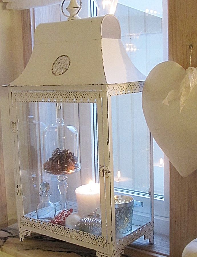 I love this lantern that includes candles and wall heart!