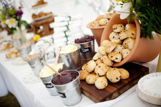 A fun way to serve a cream tea at your wedding – mini metal buckets, blackboard signs and flowerpots