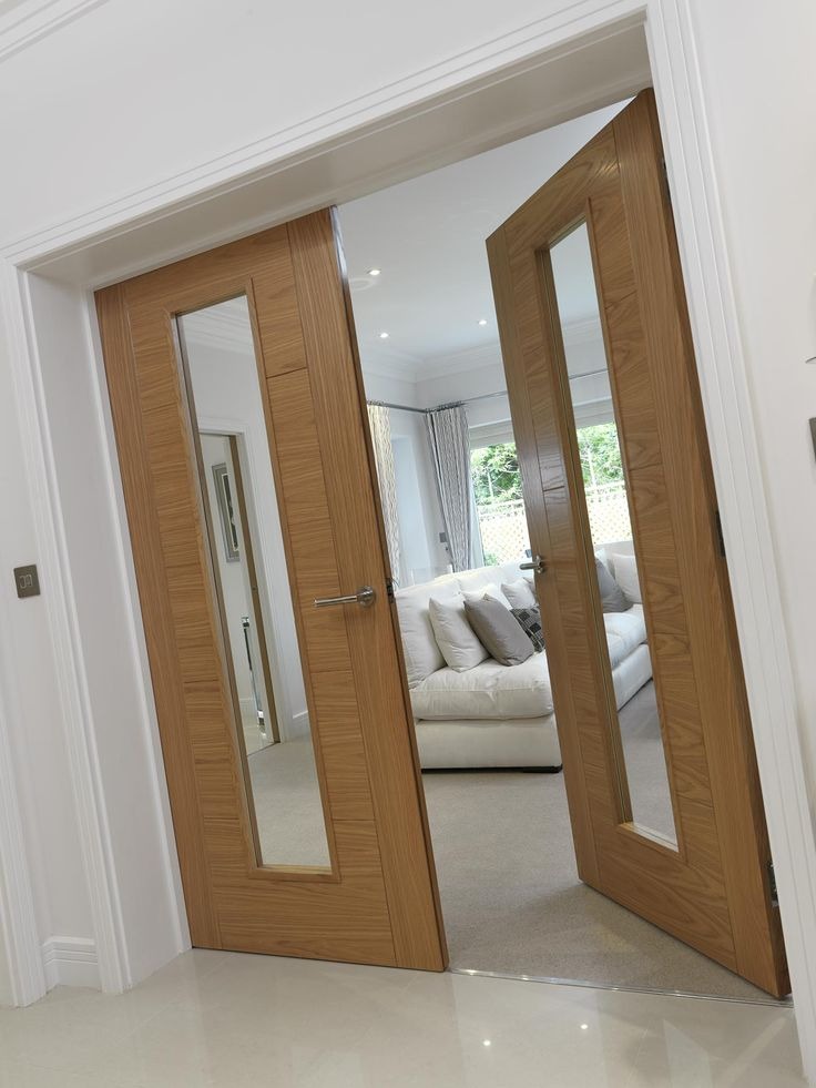 Gorgeous clear glazed oak flush #contemporarydoors.  Look great with a neutral interior.  JB Kind's River Oak - Emral
