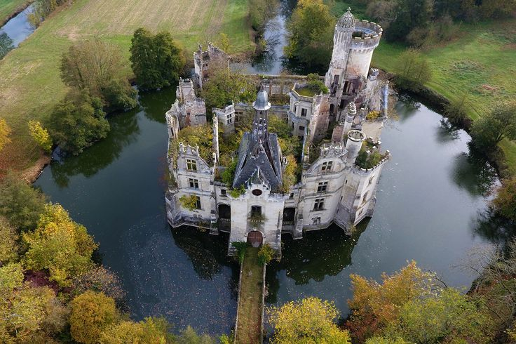 An aerial view of the ruined castle of La Mothe-Chandeniers in Les Trois-Moutiers, France, on November 3, 2017. Specializing in the rescue of old stone structures, the crowdfunding site Dartagnans.fr and the association Adopte un château recently launched a collective effort to adopt the ruined castle and give it a new life, hoping to raise 500,000 euros.