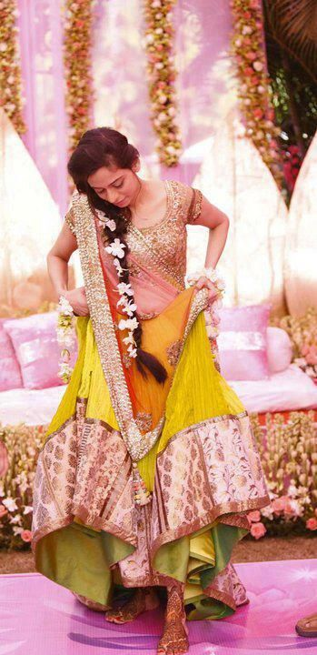 light yellowish lengha with pink top, beautiful hair, flowers in hair