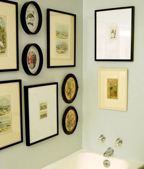 I really like the use of these frames and pictures in a bathroom. Why says that you can't do this? Not me!
