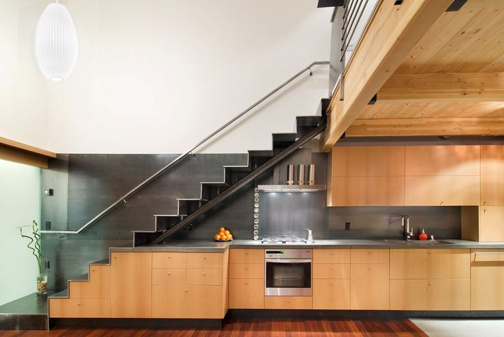 Interior Designing. Gorgeous Stunning Space-Saving Ideas with Steel Staircase and Nice Under Stairs Wooden Kitchen. Cool Interior Staircase Designs for Various Small and Wide Spaces
