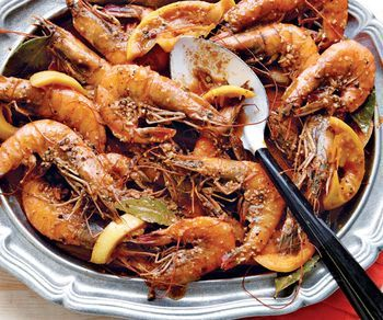 BBQ Shrimp --  lemon 8 oz. (1 cup) unsalted butter 2 Tbs. Worcestershire sauce 1 Tbs. chopped garlic 4 bay leaves 1 tsp. sweet paprika 1/4 tsp. cayenne pepper 1/4 oz. kosher salt (1 Tbs. if using Diamond Crystal, 1/2 Tbs. if using Morton's) 1/2 tsp. freshly ground black pepper 1/2 tsp. freshly cracked black pepper 24 colossal shrimp (12 to 15 per lb.), unshelled, preferably domestic wild-caught and head-on