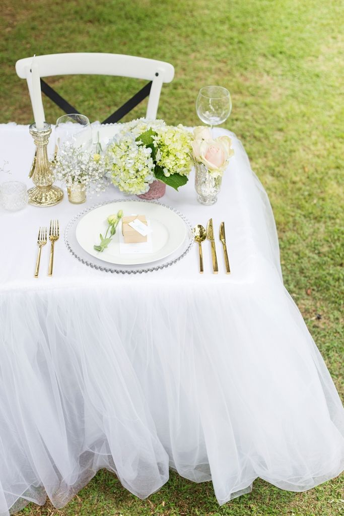 tutu tablecloth gold cutlery beaded charger plate Photography by www.facebook.com/LisaFosterPhotography  Stationery by www.facebook.com/inspiredweddings Flowers by www.facebook.com/pages/Flowers-on-Hall-Street Props by www.facebook.com/ThePrettyPropShop Gowns by www.facebook.com/girlmeetsgownpukekohe Desserts by www.facebook.com/LucysCakesandCatering Hair by www.facebook.com/DIOSAhair Venue www.facebook.com/HedgesEstate