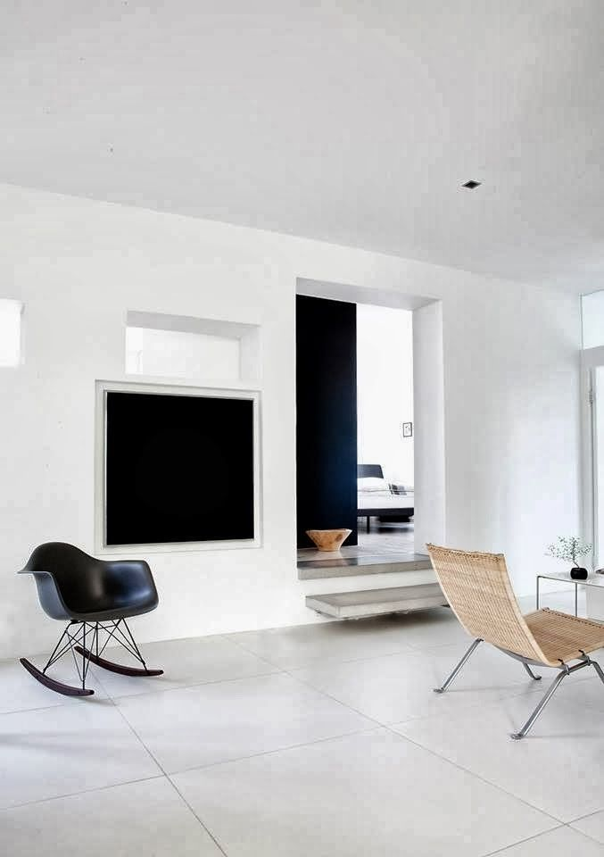 Black Eames RAR in a Danish home in monochrome by Norm Architects.