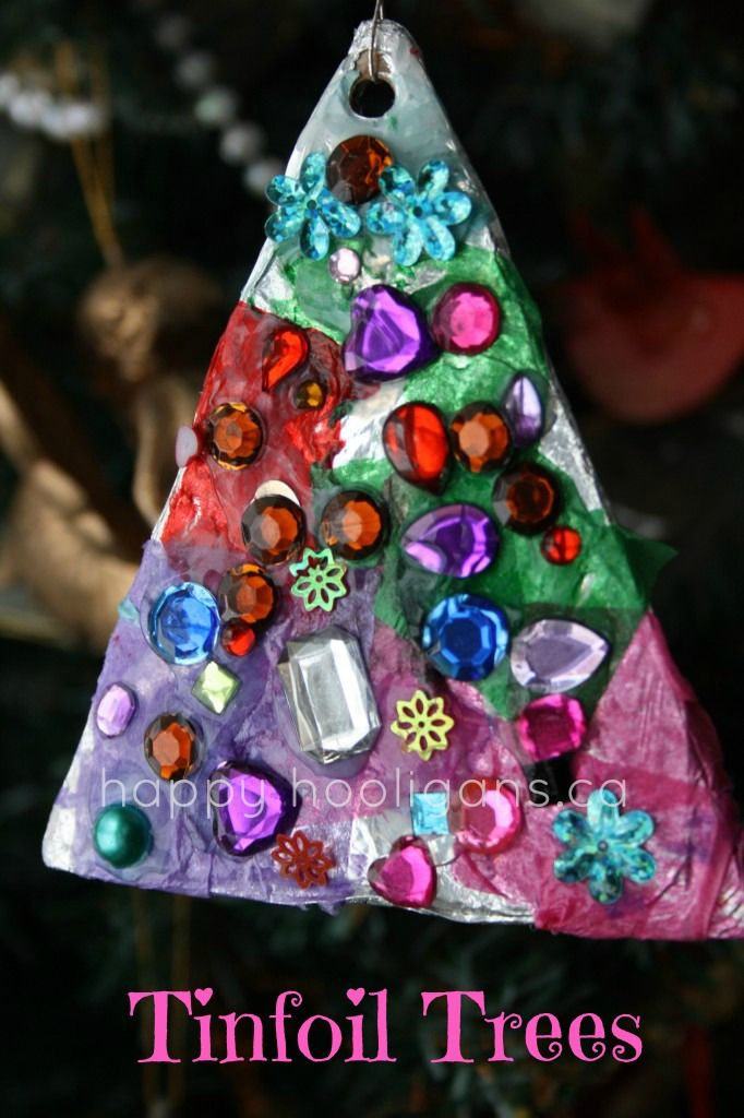 Tinfoil tree ornaments -- cover cardboard with foil. Use modge podge to stick tissue paper squares onto the front side. Coat once more with modge podge. When dry, stick jewels to the front and punch a hole at the top for hanging.