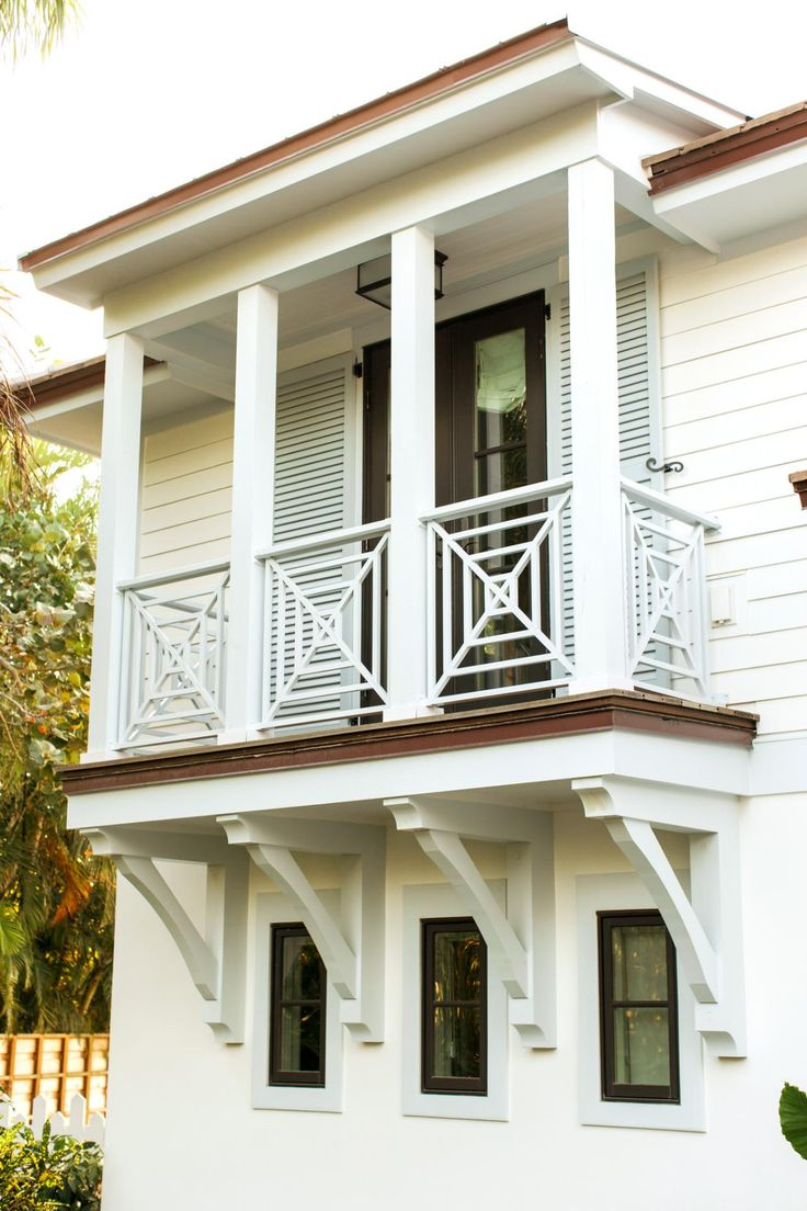The second story balcony is accessed from the master bathroom. Beefed up pillars and a Chippendale style railing were added during reconstruction of the house.