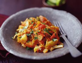 Spicy Bolivian Cabbage and Potatoes- Made this last night and added some soyrizo. Delicious!