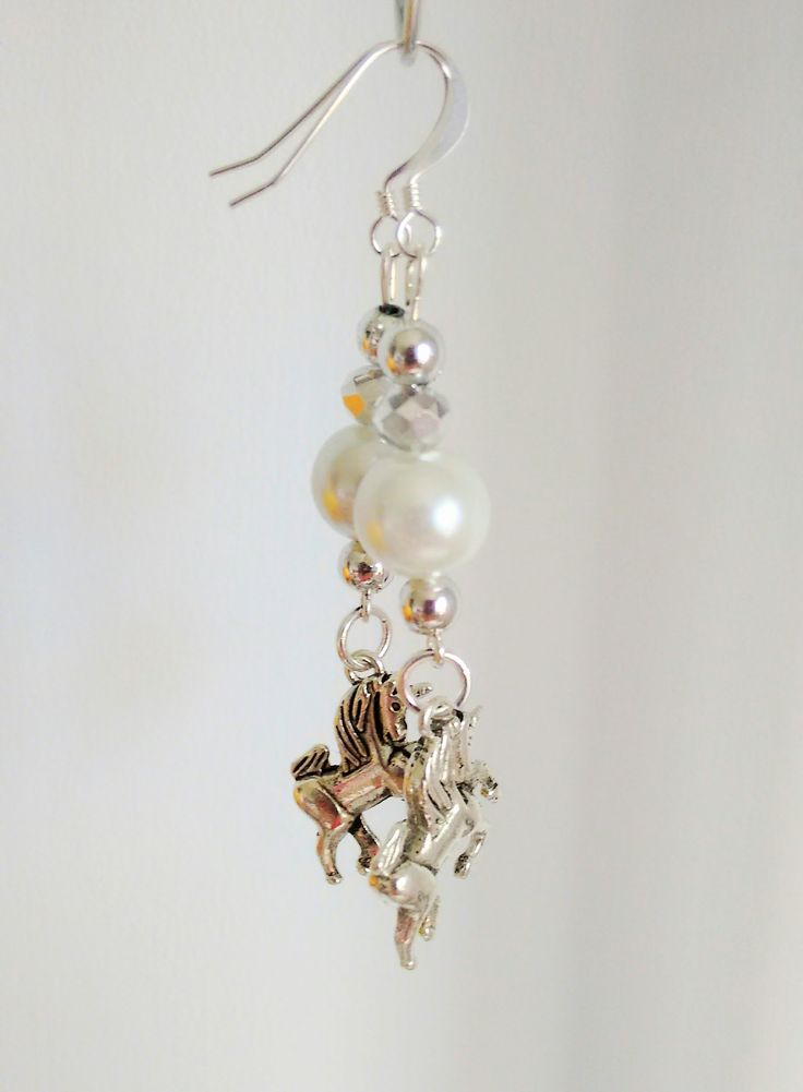 Unicorn earrings - Einhorn-Ohrringe. Silver plated ear wires head pins spacer beads and jump rings - white glass pearls - faceted glass bead 1 half clear and 1 half silver - Tibetan silver unicorn charms - they are for sale, but not yet added to anywhere else