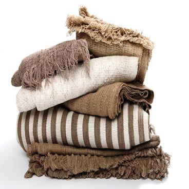 earthy, raw textiles. white/wheat/linen shades