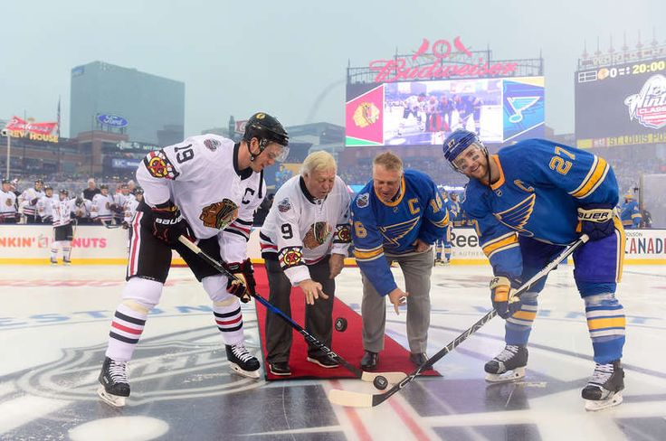 Blues vs. Blackhawks - 01/02/2017 - St Louis Blues - Photo GFormer Chicago Blackhawks player Bobby Hull, second from left, and son former St. Louis Blues player Brett Hull, second from right, drop the puck for the ceremonial opening face-off between Jonathan Toews #19 of the Chicago Blackhawks and Alex Pietrangelo #27