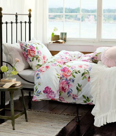 Floral bedding on Antique Iron bed frame.