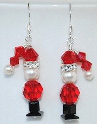 Adorable Christmas Santa Earrings made with Swarovski Crystal and Pearl Beads on Sterling Silver French Ear wires. These hang approximately 1 1/4.