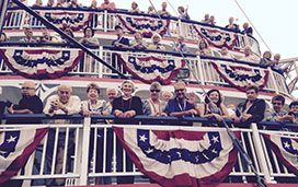 Passengers wait on the outer decks of American Cruise Lines' newest vessel, American Eagle, for the ship's christening. Photo: Keith Marshall