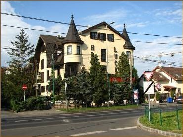 This chateau style hotel with turrets is located at only 5 kilometers (3 miles) from the historical centre, in the green belt of the city, close to the M3 highway and the fairgrounds.  http://www.tropolino.com/EN/Europe/Hungary/Budapest/Budapest/Hotels/