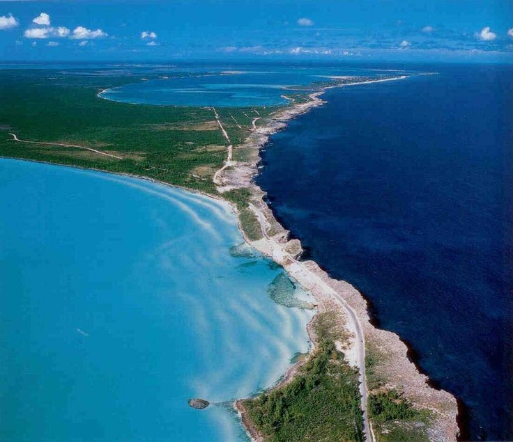 Eleuthera Out Island, Bahamas.  The inky blue Atlantic and the glistening turquoise Caribbean side by side with just a narrow concrete bridge separating them.
