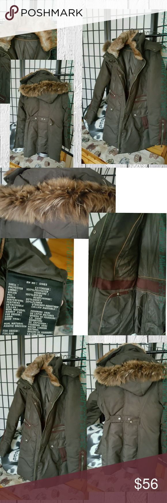 Andrew Marc down coat army green real fur Andrew Marc down coat  army olive green  real fur trim and hood  Down filled  Pockets inside Zipper works great  Excellent condition  Smoke-free closet No visible signs of wear or damage Andrew Marc Jackets & Coats Puffers