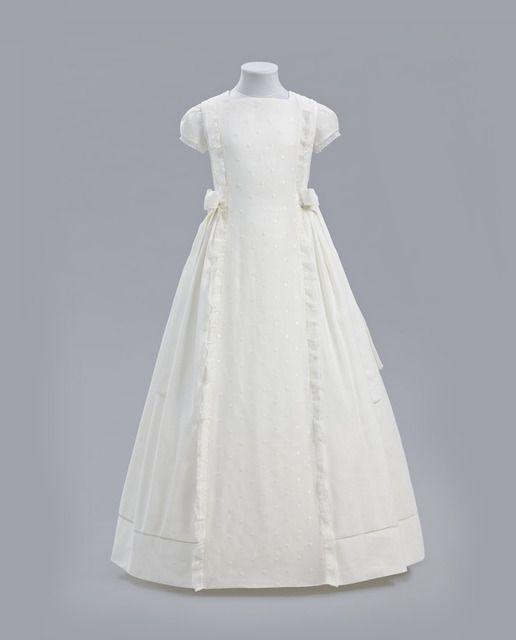 Vestido Eva de lino con bodoques y lazadas a los lados.