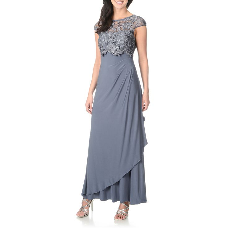 This elegant evening gown by Patra is ideal for a sophisticated yet interesting attire. A smooth hem line is given texture by a side gathering and an intricately floral designed lace pop-over boosts  this refined look.