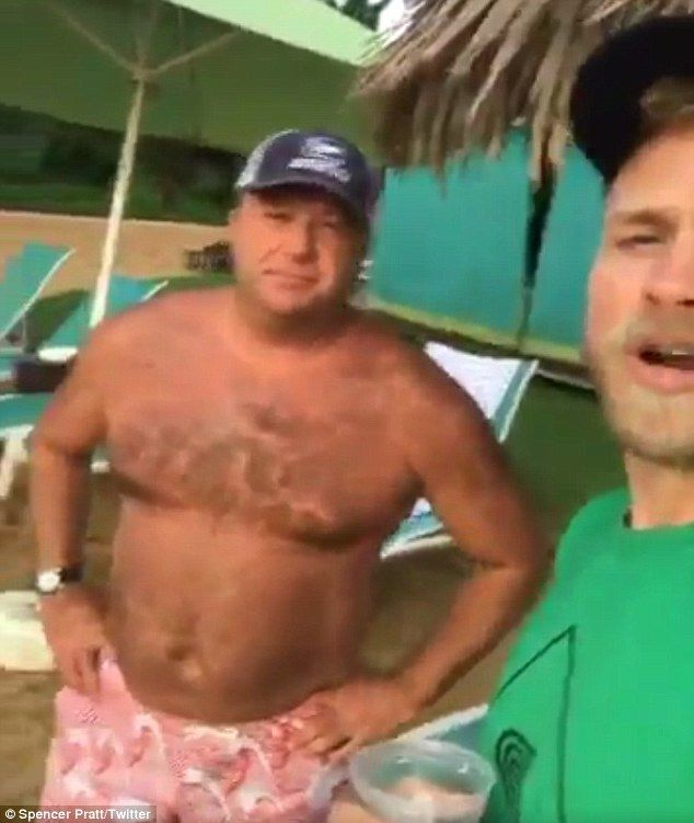 Fell the rain on your skin:Heidi Montag and Spencer Pratt are on vacation at the same Hawaiian resort as Alex Jones (above)
