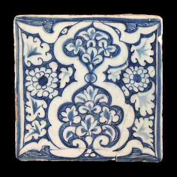 Egypt or Syria, early 15th century. A square stone paste tile crisply painted in underglaze pale blue.